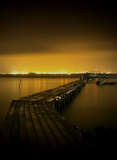 The Path Sea Sea View Nightphotography Night Lights Nightshot Long Exposure Bulbs Nightscape Bridge Photography Bridge Yellow Water Sea Reflection Beach Horizon Seascape Atmospheric Mood Low Tide