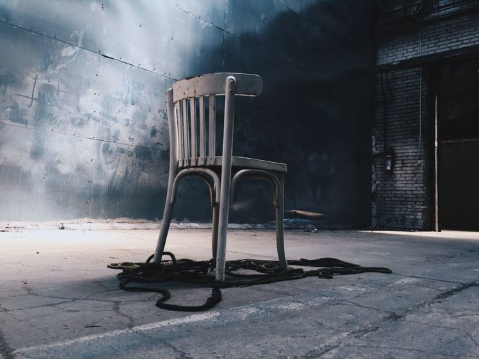 Rear View Of Abandoned Chair In Room
