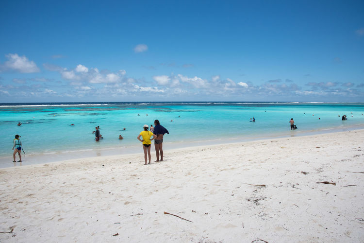 YEJELE BEACH,MARE,NEW CALEDONIA-DECEMBER 3,2016: Tourists on excursion at Yejele Beach in New Caledonia. Exotic Lifestyle Snorkeling Swimming Travel Vacations Azure Beach Blue Destination Enjoying Life Exploration Full Length Leisure Activity Lifestyles Looking At View New Caledonia Pacific Ocean Recreational Pursuit Remote Sand Sea Togetherness Turquoise Water Yejele