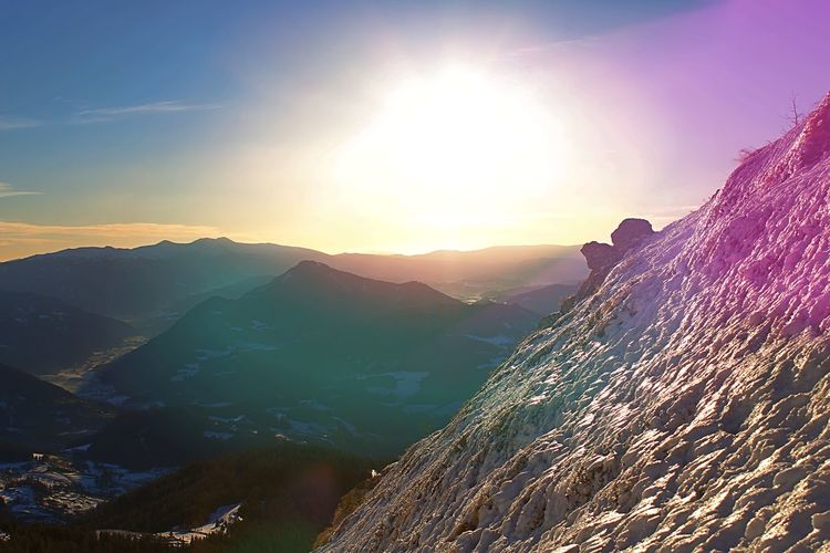 Mountain Scenics - Nature Beauty In Nature Sky Sunlight Tranquil Scene Mountain Range Tranquility Sun Non-urban Scene Sunbeam Nature Environment Idyllic Landscape Lens Flare Remote Adventure Outdoors Physical Geography Mountain Peak Bright