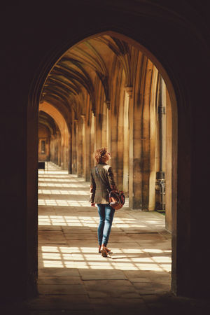 Alone Arch Architectural Column Architecture Archway Built Structure Corridor Countour Curly Hair Front View Full Length Girl Indoors  Leisure Activity Lifestyles Person Rear View Shadow Standing The Way Forward Walking The Portraitist - 2016 EyeEm Awards Feel The Journey 43 Golden Moments People And Places The Secret Spaces Breathing Space Fashion Stories An Eye For Travel