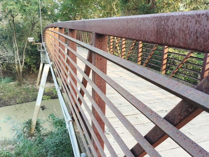 Terry Hershey Park, bridge over South Mayde Creek. Railing Day No People Outdoors Built Structure Architecture Nature Bridge Scenics Beauty In Nature Creek Terry Hershey Park Water Rust Metal Houston Texas CanadianInAmerica
