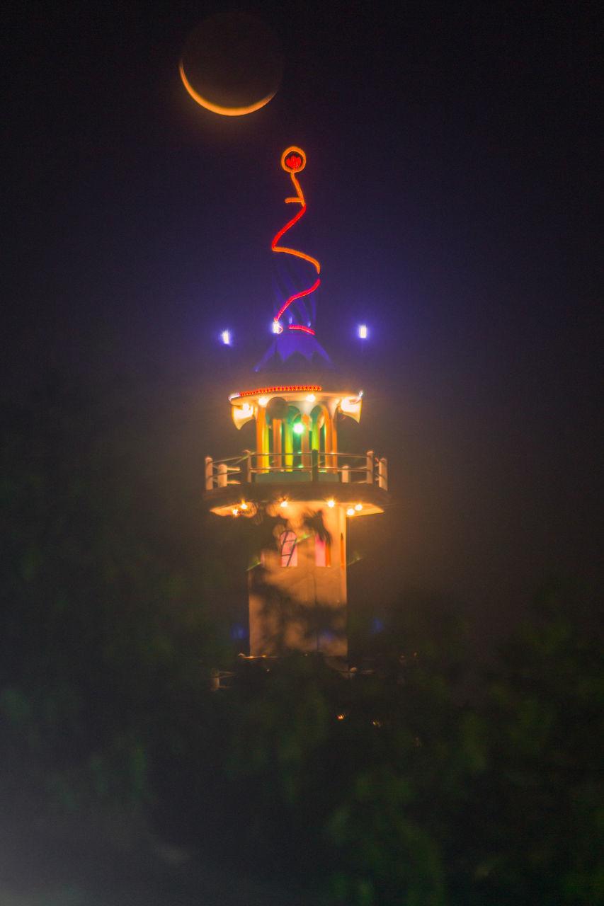 ILLUMINATED SIGN AGAINST SKY AT NIGHT