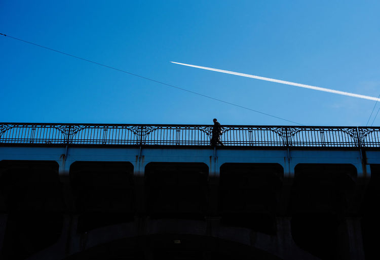 Warsaw in Spring The Week on EyeEm Light And Shadow Capture The Moment The Art of Street Photography Nikonphotography Nikon D750 Spring Traveling Daily Life Sky Railing Blue Bridge Built Structure Nature Connection Architecture Transportation Bridge - Man Made Structure Men Silhouette Real People Day Lifestyles Outdoors People Low Angle View Clear Sky Leisure Activity Vapor Trail