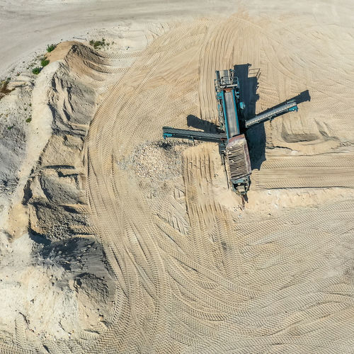 Aerial view of the processing machine, the extractor, in a sand quarry Aerial View Processing Machine Extractor Mining Operation Sand Material Pit Quarry Outdoor Environment Sorting  Cone Equipment Mineral Dust Work Sunny Crusher Processing Quarrying Earth Conveying Aggregate Gravel Crushed Excavator Aerial Photo Aerial Photograph Drone  Drone Flight From Above  In Flight Flight Flying High Height Drone Landscape Aerial View Open Cast Mining Industry Mining Mining Industry Raw Material Raw Death Lake Sand Quarrying