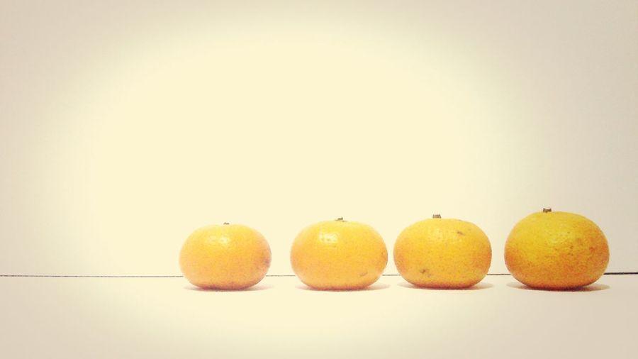 Close-up of yellow orange fruit in row