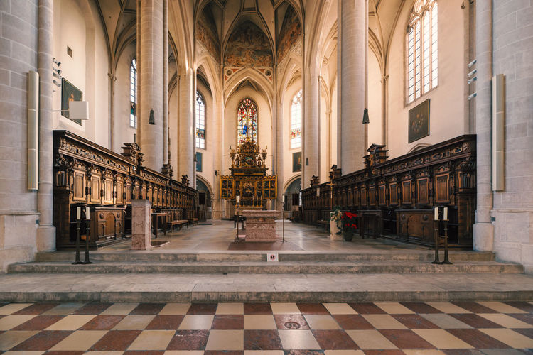 "Interior of famous church ""Münster zur schönen unseren lieben Frau"" in Ingolstadt Architecture Built Structure Building Religion Place Of Worship Arch Flooring Spirituality Tile Belief Indoors  Tiled Floor Architectural Column Day The Past Travel Destinations Aisle Ceiling Gothic Style"
