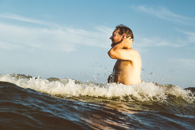 Adult Fun Man Shirtless Blue Day Male Nature Ocean One Person Outdoors Person In Nature Real People Relaxation Rewilding Sea Sky Vacation Water Wave