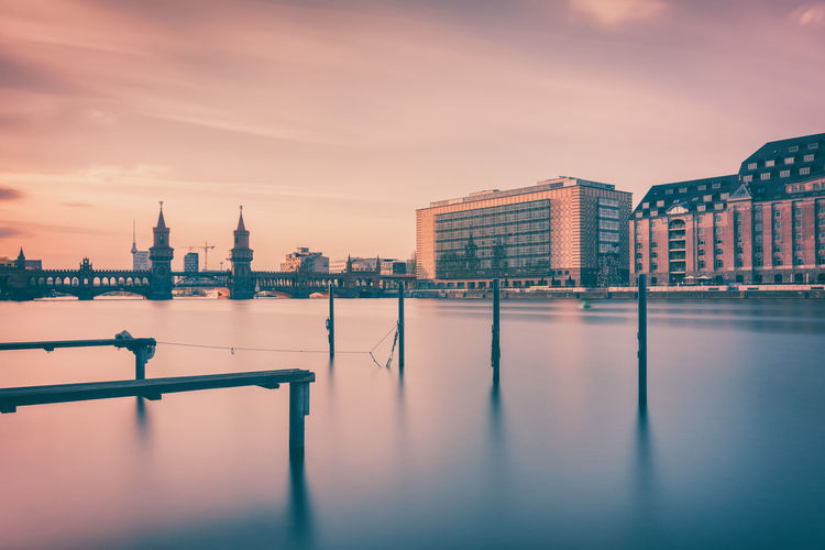 Calm river with buildings in distance