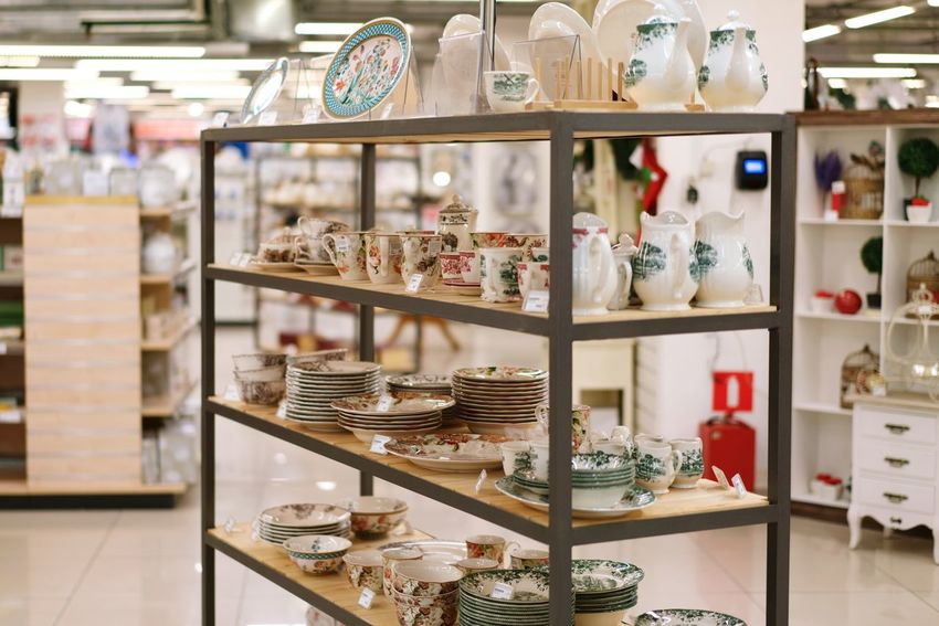Shelf Choice Indoors  In A Row Retail  No People Large Group Of Objects Store Old-fashioned Afternoon Tea Ceramics Porcelain  Cup Dishes Plates Tea Set Dishes Set Shopping For Sale Arrangement White Color Plate Teapot Fragility Shelves