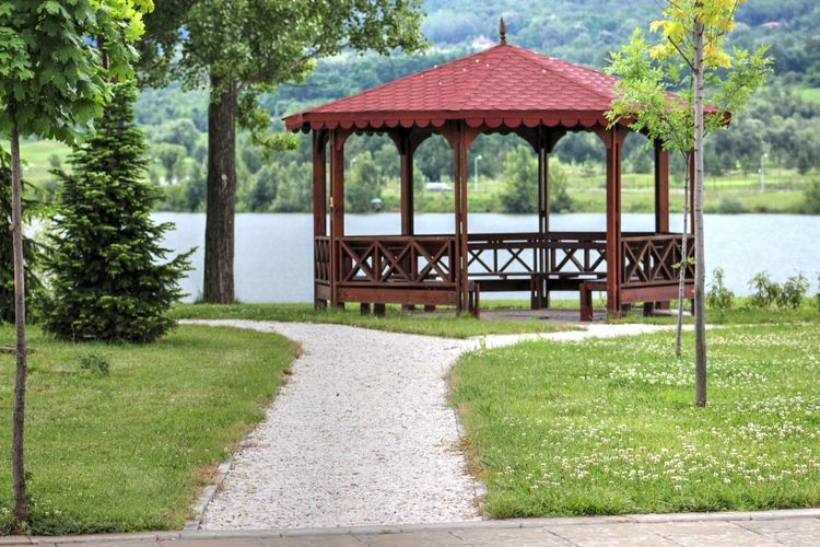 Gazebo by lake in park