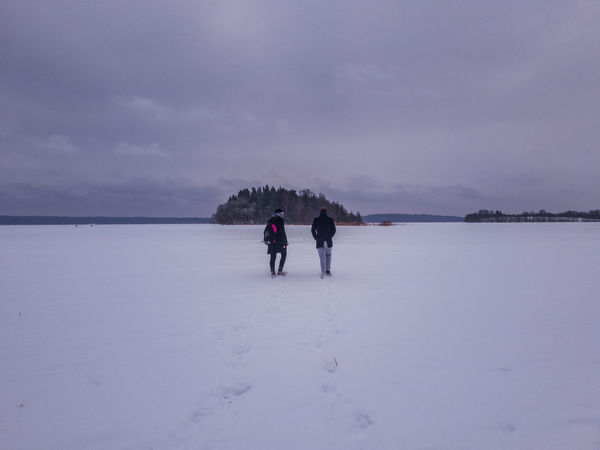 Just a walk on the frozen lake EyeEmNewHere Cloud - Sky Clouds Red Water Frozen Lake Island Winter Cold Temperature Full Length People Snow Lake Child Outdoors Togetherness Day Beauty In Nature Adult Nature Sky The Traveler - 2018 EyeEm Awards The Still Life Photographer - 2018 EyeEm Awards The Great Outdoors - 2018 EyeEm Awards The Creative - 2018 EyeEm Awards