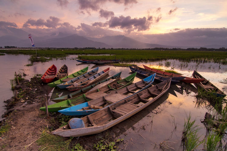 Panoramic View Of Boats Moored At Beach Against Sky During Sunset