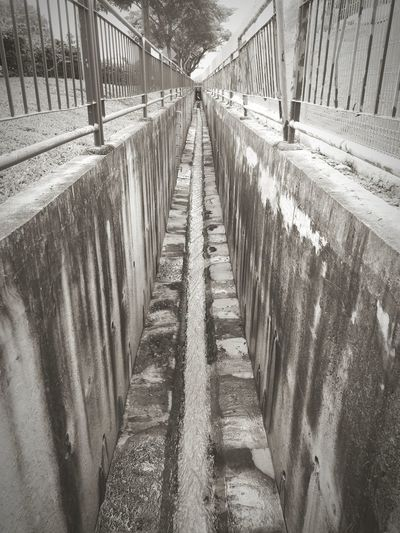 water in the drain Lines Lines And Angles Lines And Shapes Water Drain Drainage Straight Line Forward Straight Lines Fencing Drainage Channel Waterflow Blackandwhite Eye4photography  Eye4photography  EyeEm Best Shots EyeEm Gallery EyeEm Best Shots - Black + White Eyeemphoto