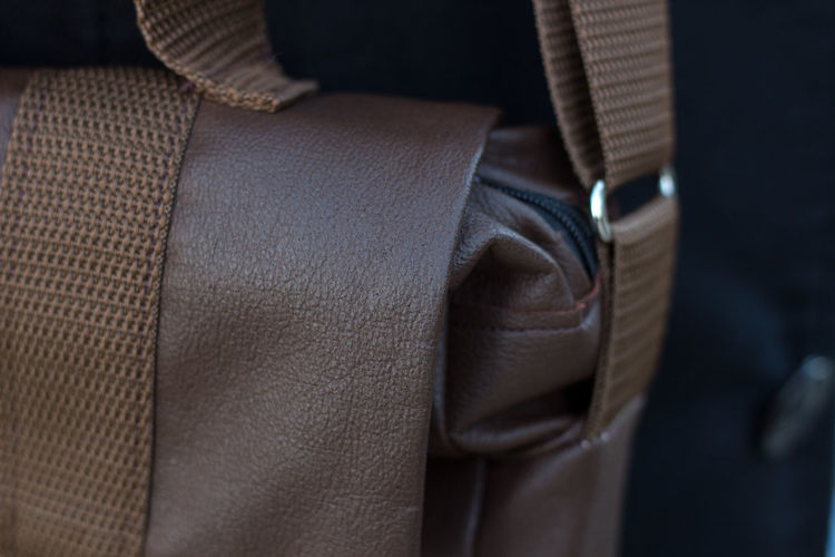 Close-up of brown leather bag