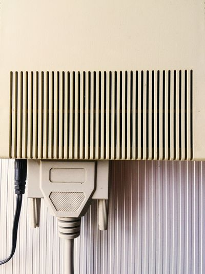 Close-up of plug against the wall