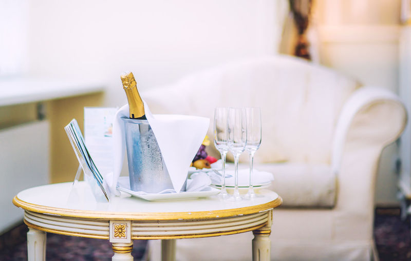 Close-Up Of Champagne Bottle On Table In Hotel Room