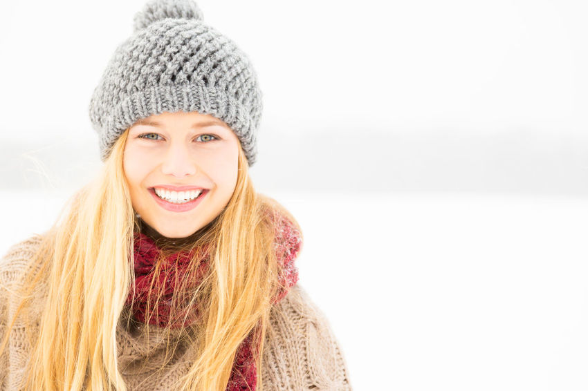 Young blonde woman in the snow Beautiful People Beautiful Woman Beauty Blonde Blonde Woman Cold Temperature Fun Happiness Happy Headshot Knit Hat Lifestyles One Person One Young Woman Only Outoors Portrait Scarf Smiling Snow Warm Clothing Winter Winter Young Adult Young Women