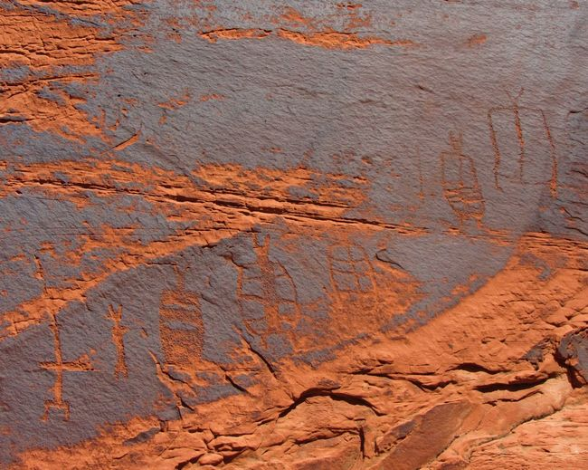 Petroglyphs on a canyon wall, Glen Canyon, Arizona. Arizona Ancient Arid Climate Backgrounds Close-up Day Full Frame Geology Nature No People Outdoors Petroglyphs Red Rock - Object Rock Art Textured