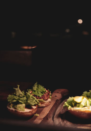 Close-up of meal served on table against black background