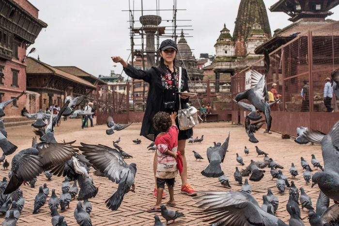 Kathmandu, Nepal Bird Photography Feeding The Birds Travel Photography Vocation Streetphotography Instaphotography Instaphoto Life Building Exterior Full Length Riding Mammal Human Leisure Activity Lifestyles Casual Clothing City Motion Person Day Children Photography Freedom