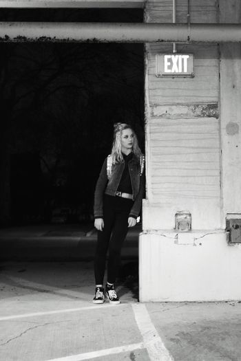 Full Length Of Woman Leaning On Wall