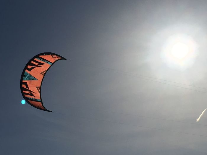 Sky Low Angle View Leisure Activity Nature Sport Adventure Extreme Sports Paragliding Parachute Real People Sun Unrecognizable Person One Person Joy Sunlight Lifestyles Outdoors Day Parasailing Flying