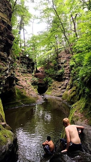 My Son and I on one hell of an adventure not far from home. Slice of paradise in Baraboo Wisconsin. Pewits Nest Waterfalls. We hiked started from the top through water rocks, and multiple waterfalls and natural swimming pools. It was amazing! The photo shows my son getting ready to climb down one of many waterfalls. Waterfall Waterfalls Waterfall_collection Waterfall #water #landscape #nature #beautiful Enjoying Life Pewits Nest Swimming Water Rocks Green Wisconsin Baraboo Water Reflections Moss Sandstone Water Reflection Wisconsin Life Wisconsinstyle Breathtaking Paradise Original Experiences Showcase: June Adventure Club Colour Of Life Two Is Better Than One