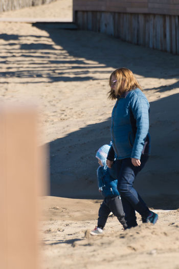 Full length of woman on sand
