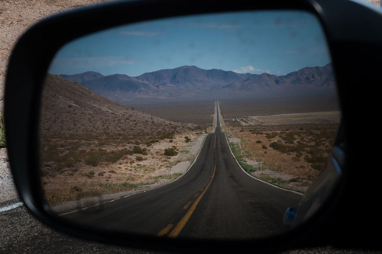 Country Road Seen In Side-View Mirror Of Car