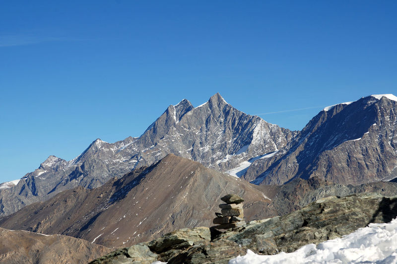 Scenic view of majestic mountain range against clear blue sky