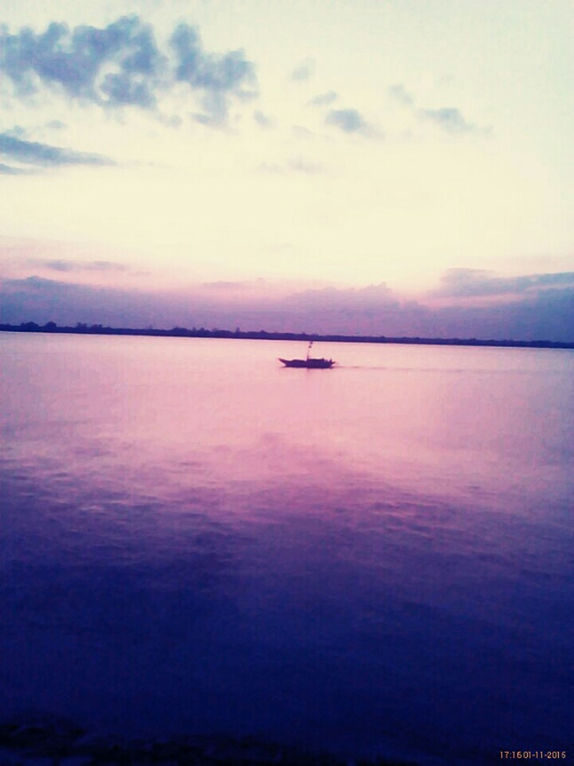 water, tranquil scene, sunset, tranquility, scenics, nautical vessel, sky, beauty in nature, waterfront, transportation, boat, nature, silhouette, mode of transport, sea, lake, cloud - sky, idyllic, reflection, calm