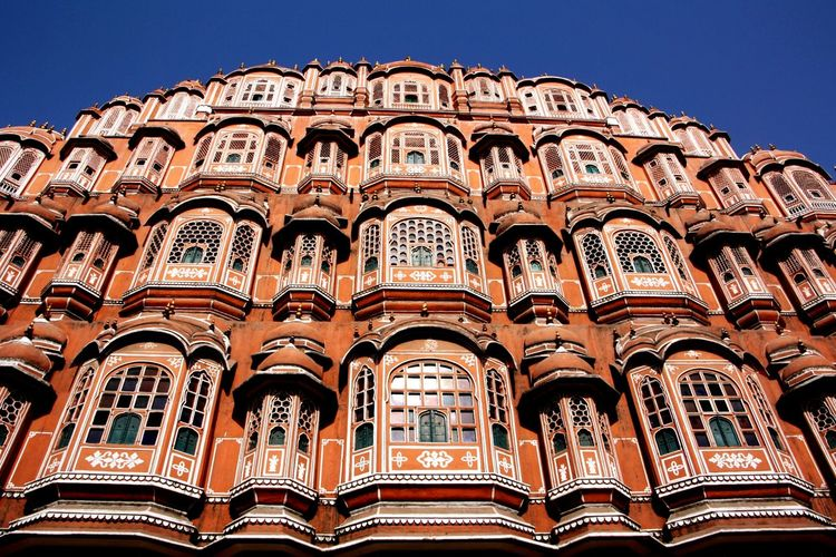 Low angle view of hawa mahal against clear blue sky during sunny day