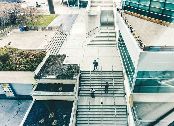 High angle view of people walking on stairs