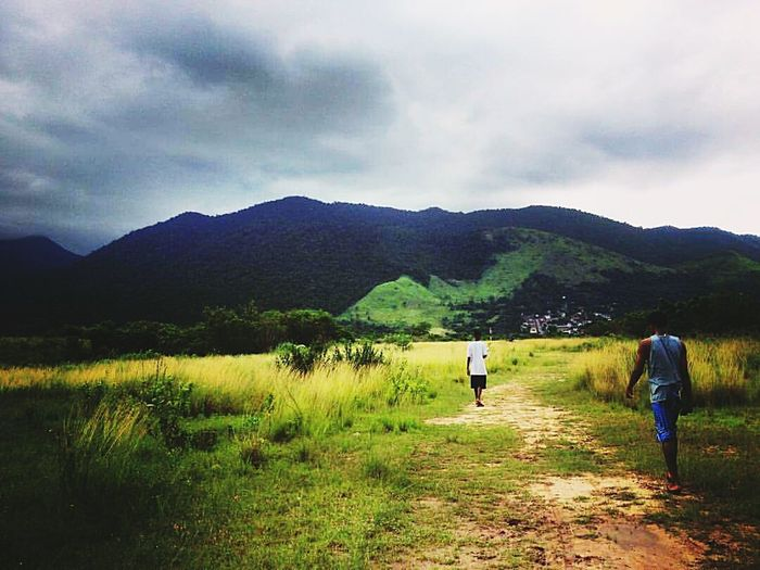 Mountain Walking Adult Two People People Nature Rural Scene Landscape Togetherness Men Beauty In Nature Grass Sky Cloud - Sky Rear View Full Length City Nature Tree
