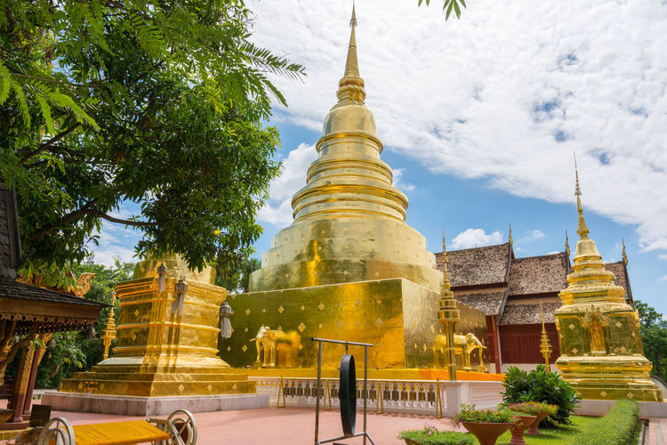 Wat Phra Sing in Chiang Mai Province ,Thailand Architecture ASIA Asian  Asian Culture Building Exterior Built Structure Chiang Mai Day Famous Place Gold Gold Colored Landmark Outdoors Place Of Worship Religion Siam Sky Spirituality Temple Thailand Tourism Traditional Travel Destinations Tree Wat Phra Sing