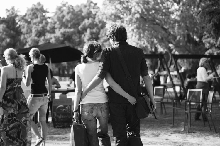 Lovers, love couple at Aachener Weiher. Real People Tree Lifestyles Leisure Activity Togetherness Casual Clothing Outdoors Men Walking Rear View Day Women Happiness Friendship Young Adult Bonding Young Women Adults Only Adult People Couple Monochrome Blackandwhite Black And White Fine Art Photography