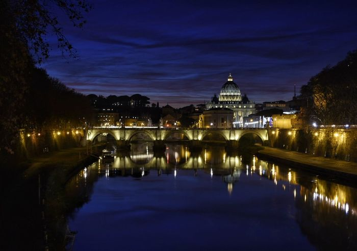 Saint Angelo's Bridge in front of Saint Peter Basilica Long Exposure Saint Angelo Bridge Saint Peter's Basilica Tiber River Night Sunset Reflection Bridge - Man Made Structure Arch Architecture Sky Cityscape River Dusk Illuminated City Ornate Water Cloud - Sky Blue Outdoors Scenics
