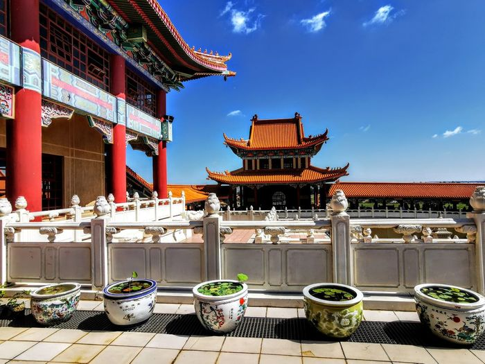 Chinese water pots with view of  temple