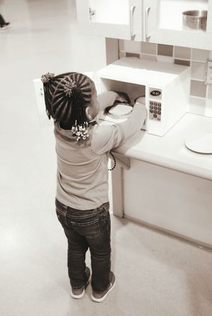 Little Girl Pretend Cooking Children's Museum Braids Cute Photography
