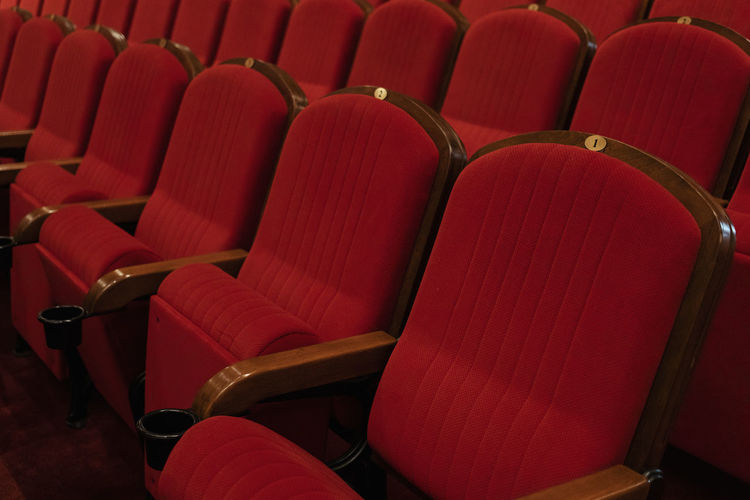 Seat Chair Red Arts Culture And Entertainment In A Row Movie Theater Empty Auditorium Indoors  No People Repetition Absence Stage Theater Order Side By Side Comfortable High Angle View Backgrounds Event Theatrical Performance Armchair Stage Foldable Luxury Cinema Sinema Teather Empty Chair