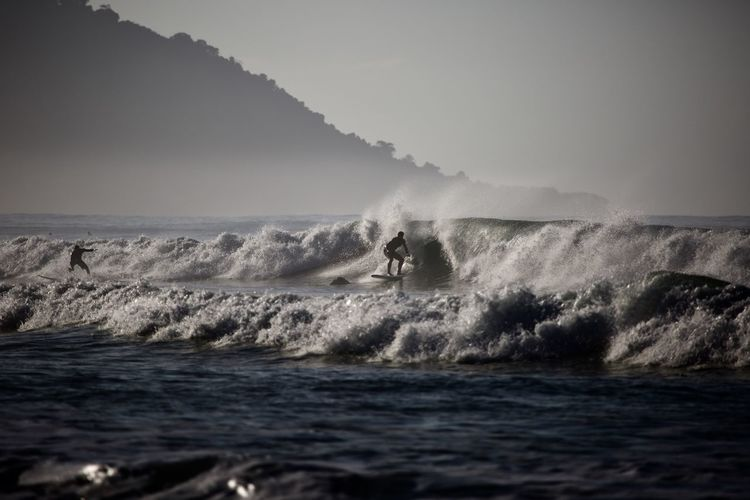 Water Sea Motion Sport Wave Power Beauty In Nature Power In Nature Nature People Sky Aquatic Sport Surfing Men Adventure Unrecognizable Person Scenics - Nature Day Outdoors Horizon Over Water