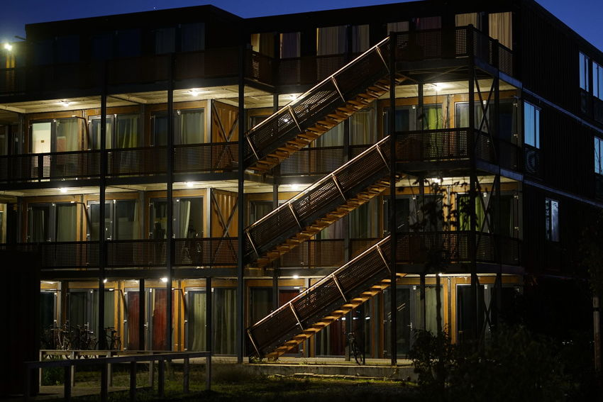 Container Architecture Built Structure Building Exterior Night No People Building Illuminated Staircase City Outdoors Nature Metal Railing Steps And Staircases Lighting Equipment Reflection Low Angle View Window Residential District Industry Apartment