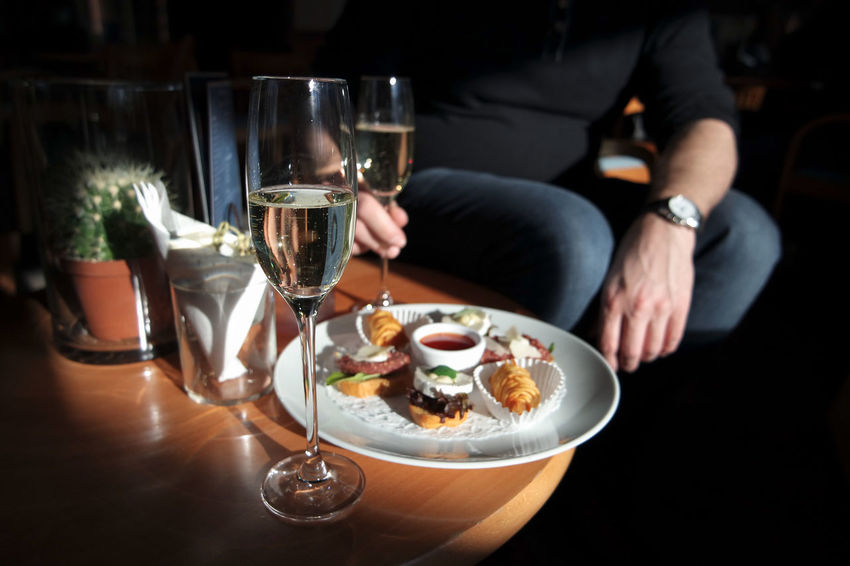 Afternoon Sunlight Bubbles Champagne Snack Adult Alcohol Apetizer Close-up Day Drink Drinking Glass Food Food And Drink Freshness Human Hand Indoors  Plate Plate Of Food Restaurant Sitting Table Table For Two Tastyfood Wine Wineglass