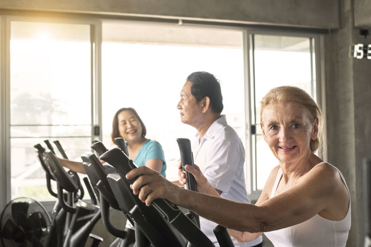 Portrait of smiling woman exercising at gym