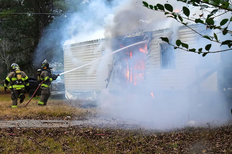 burning house with firemen fire fighters at work Accidents And Disasters Burning Danger Day Emergency Equipment Fire Hose Firefighter Flame Headwear Heat - Temperature Helmet Men Motion Occupation Outdoors Protection Protective Suit Protective Workwear Real People RISK Smoke - Physical Structure Spraying Steam Water Working