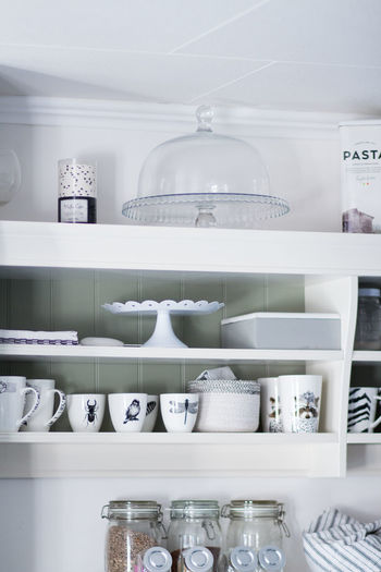 Arrangement Ceramics Choice Container Crockery Cup Domestic Room Household Equipment Indoors  Jar Kitchen Life Large Group Of Objects No People Order Rack Retail  Shelf Shelves Still Life Variation White Color