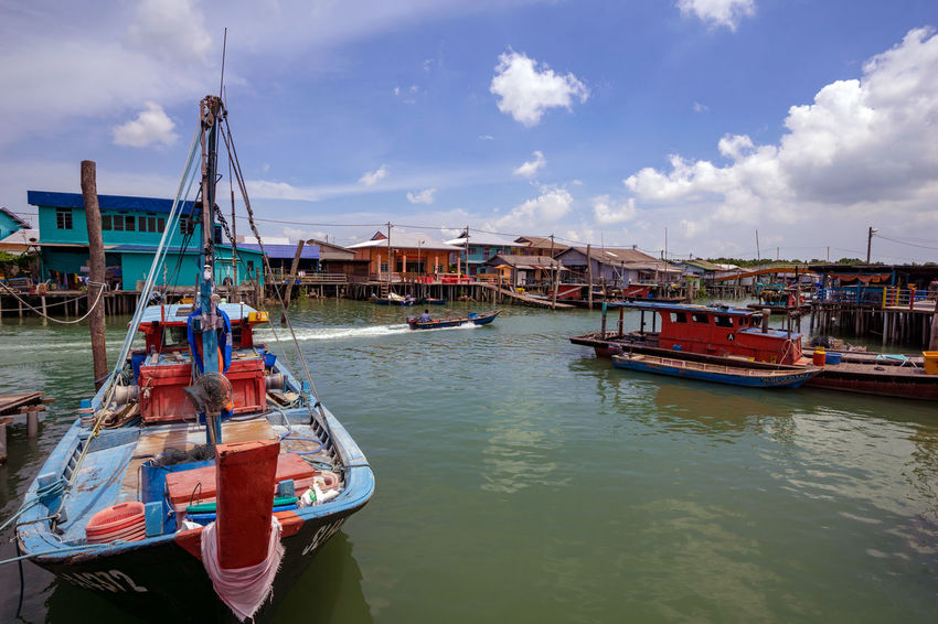 PULAU KETAM, MALAYSIA - 6th AUG 2018; A view of a fishermen's village on stilts besides the sea in Pulau Ketam (Crab Island). This island is famous for sea food products and restaurants. Anchored Architecture Building Exterior Built Structure Cloud - Sky Crab Island Day Fishing Boat Harbor Mast Mode Of Transportation Moored Nature Nautical Vessel No People Outdoors Pole Port Pulau Ketam Malaysia Sailboat Sea Sky Transportation Water Waterfront