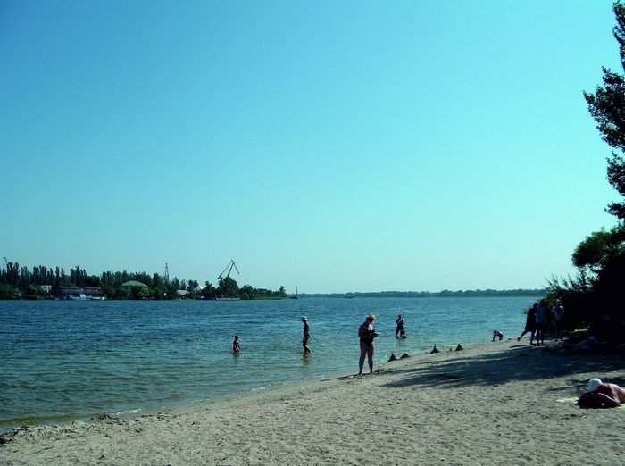 Dniepr beach in Kherson Summer Views River Bank  River Life Relax Time  Summer Vacations Travel Photography Nature Photography City Beach Horizon Over Water Water Tree Beach Sand Men Women Blue Playing Sky Calm