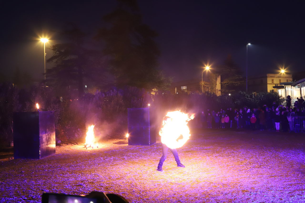illuminated, night, glowing, lighting equipment, street, burning, fire, real people, city, street light, flame, group of people, nature, fire - natural phenomenon, motion, architecture, celebration, long exposure, heat - temperature, sky, light